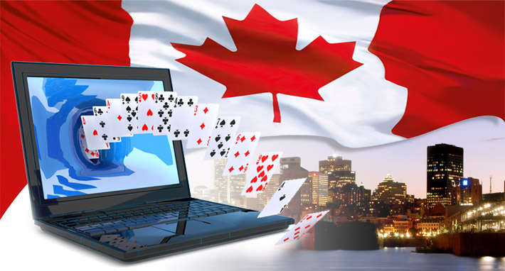 canadian flag with laptop and casino cards